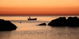 Pescador en el amanecer Foto de archivo libre de regalías