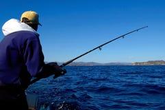 Pescador en la acción Imagen de archivo libre de regalías
