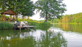 Pescador en la acción Imágenes de archivo libres de regalías
