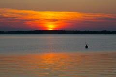 Pescador en la puesta del sol Fotografía de archivo