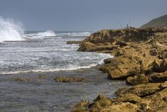 Pescador en la roca de la misión Imagen de archivo libre de regalías