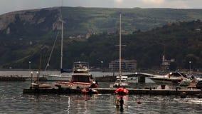 Pescador en puerto metrajes