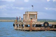 Pescador At The End del muelle de Antilla en Cuba Fotografía de archivo libre de regalías