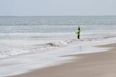 Pescador joven en la playa Imagen de archivo libre de regalías