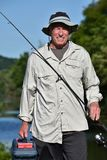 Pescador masculino And Happiness With que pesca Rod Outdoors fotografia de stock royalty free