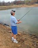 Pescador mayor en el lago Imagenes de archivo