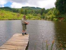 Pescador mayor fly-fishing Fotografía de archivo libre de regalías