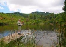 Pescador mayor fly-fishing Imagen de archivo