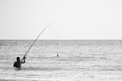 Pescador na água Fotografia de Stock Royalty Free