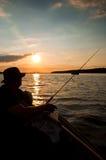 Pescador na noite Imagem de Stock