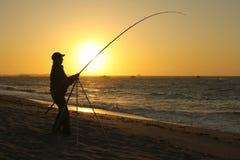 Pescador na praia Imagens de Stock