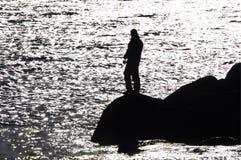 Pescador na reflexão. Imagem de Stock