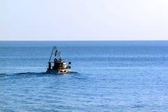 Pescador no barco Fotografia de Stock