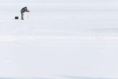 Pescador no gelo Imagens de Stock