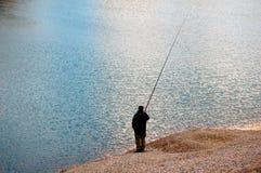 Pescador no lago Foto de Stock Royalty Free