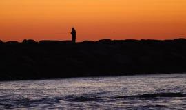 Pescador no molhe Imagem de Stock Royalty Free