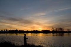 Pescador no nascer do sol Foto de Stock