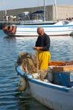 Pescador no trabalho Imagens de Stock