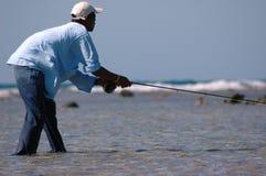 Pescador nos planos imagens de stock
