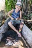 Pescador novo com uma captura Imagens de Stock