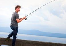 Pescador novo Fishing Mackerel fotos de stock