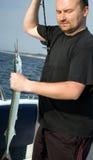 Pescador orgulloso imagenes de archivo