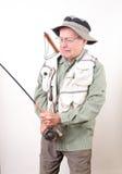 Pescador que aspa en su retén fotos de archivo libres de regalías