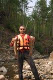 Pescador que guarda dois grandes lenoks Foto de Stock Royalty Free
