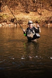 Pescador que guarda um timalo travado Imagens de Stock