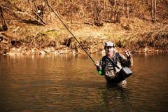 Pescador que guarda um timalo travado Imagens de Stock Royalty Free