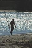 Pescador Silhouette pela praia fotos de stock