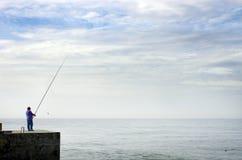 Pescador y el océano Imágenes de archivo libres de regalías