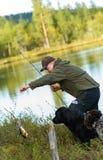Pescador y perca Fotografía de archivo