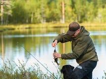 Pescador y perca Foto de archivo libre de regalías