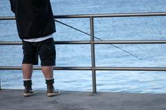 Pescador y poste. Foto de archivo libre de regalías