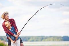 Pescadores alegres foto de stock
