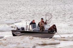 Pescadores atrapados en hielo Foto de archivo libre de regalías