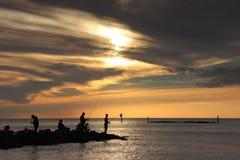 Pescadores de la puesta del sol en Marco Island South Beach Imagen de archivo libre de regalías