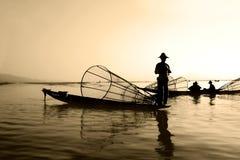 Pescadores en el agua Foto de archivo libre de regalías