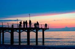 Pescadores en un muelle Foto de archivo libre de regalías