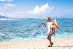 Pescadores na praia tropical Imagens de Stock Royalty Free