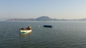 Pescadores no mar calmo Imagens de Stock Royalty Free