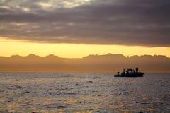 Pescadores no nascer do sol Fotografia de Stock Royalty Free