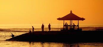 Pescadores no nascer do sol Imagens de Stock Royalty Free