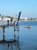 Pescadores no porto de Paphos Imagens de Stock