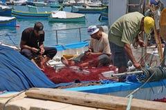 Pescadores no trabalho, Malta Fotografia de Stock