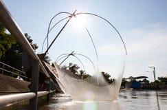 Pescadores que pescan la adulación Imagen de archivo