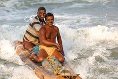 Pescadores que vuelven a casa del mar Foto de archivo libre de regalías