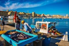 Pescadores y captura fresca Fotografía de archivo libre de regalías