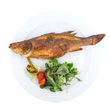 Pescados asados a la parrilla de la lubina con las verduras Foto de archivo libre de regalías